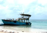A moored fishing boat on the island of Caye Caulker, Belize
