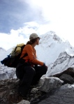 A trekker surveys the challenge ahead in the Himalayas, Nepal