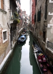 A typical canal (complete with gondola) in Venice, Italy