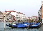 A line of gondolas on one of the larger canals in Venice, Italy